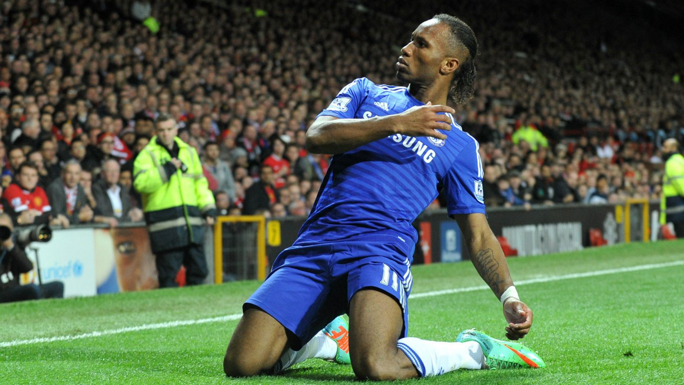 didier-drogba-sliding-on-his-knees