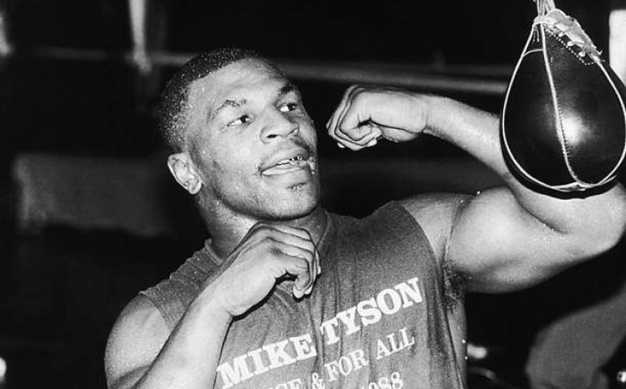 588a63ba-4734-4c1e-8a74-41a30a0a0a64-young-mike-tyson-practicing-in-gym-photo-u1-718x446
